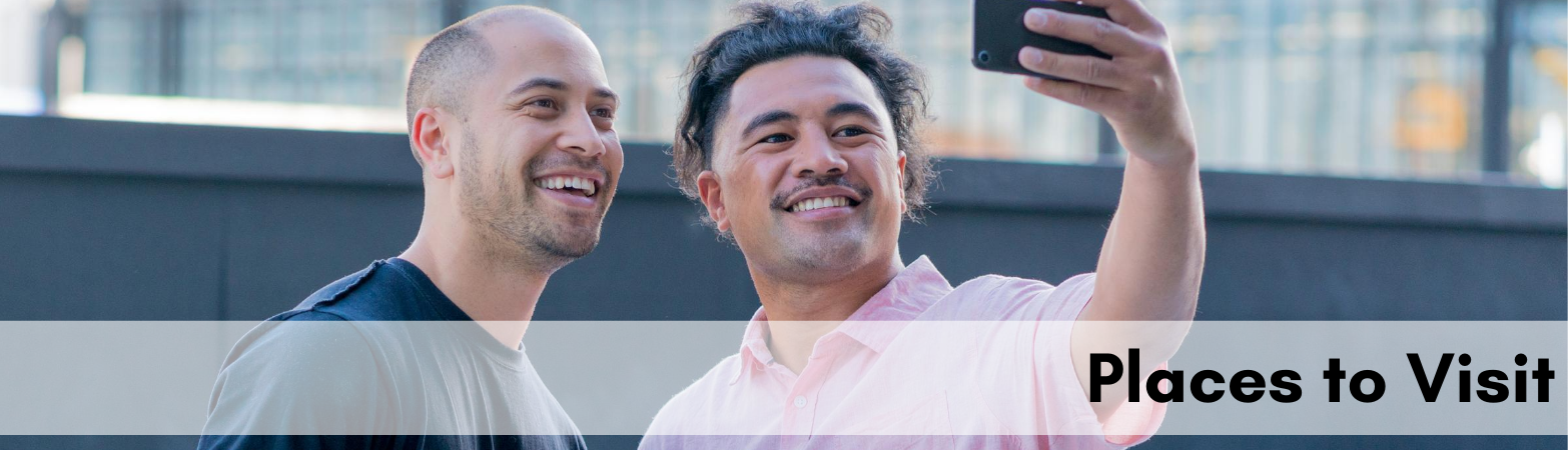 """two polynesian men smiling for the camera with text """"places to visit"""""""